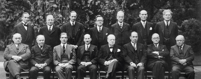 The Churchill Coalition Government 11 May 1940 - 23 May 1945: The Churchill Coalition War Cabinet: standing, from left to right, Sir Archibald Sinclair, Mr A V Alexander, Lord Cranborne, Herbert Morrison, Lord Moyne, Captain Margesson and Brendan Bracken. Seated, from left to right, Ernest Bevin, Lord Beaverbrook, Anthony Eden, Clement Attlee, Winston Churchill, Sir John Anderson, Arthur Greenwood and Sir Kingsley Wood.