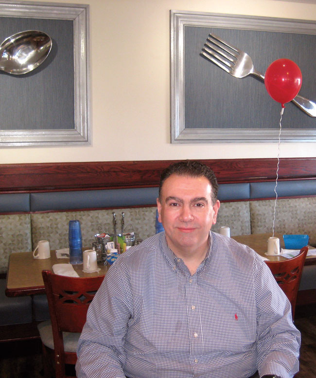 George Nikolopoulos inside his restaurant BLUEBERRY HILL CAFE at 4028 147th St Midlothian, IL.