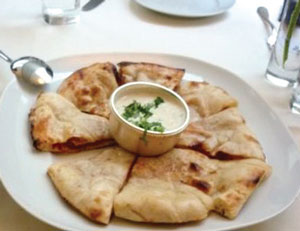 At Tamarind Tribeca, na'an bread with a yogurt mint sauce as condiment.