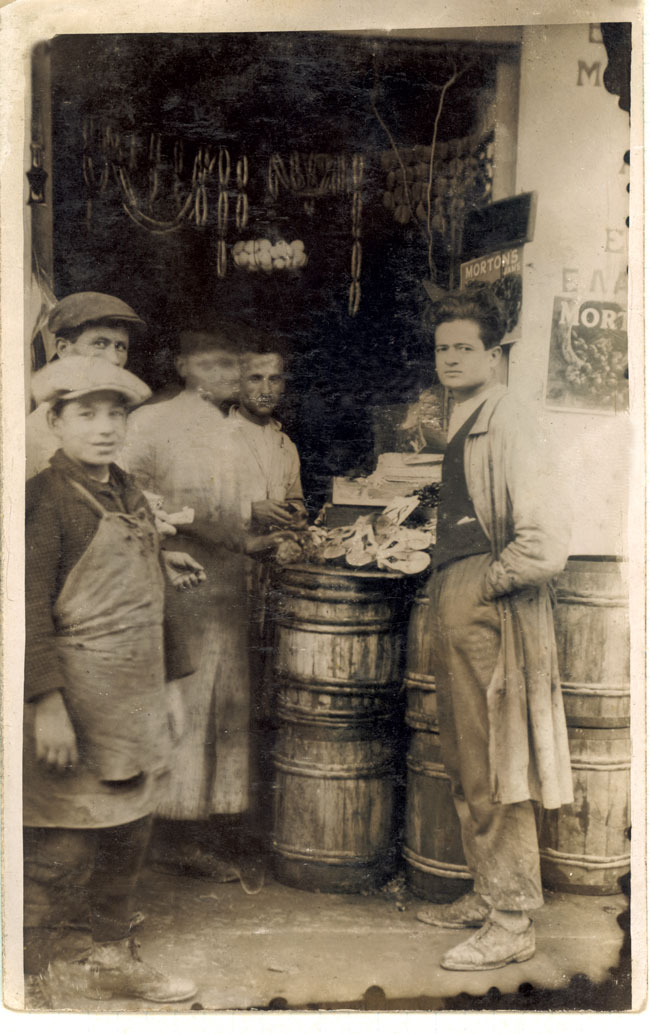 The first little store opened in 1920 on Retsinas Street in Peraeus by the three Loumidis brothers. Jason Loumidis, father of Sotiris Loumidis, at right.